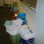 The gifts collected for the residents of Cooper Village lined an entire wall of an Aureus Group conference room!